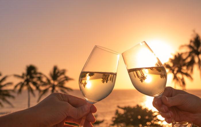 cheers wine glasses on the beach